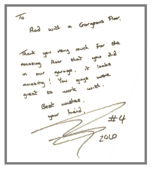 "Race-car driver Dan Wheldon autographed a copy of his book, ""Lionheart,"" with this inscription for artisan Rod Burton as a ""thank you"" for the new garage floor."