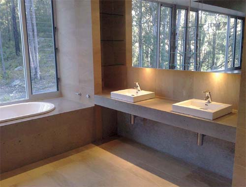 Brewer Bathroom, concrete countertop and bathtub surround, sinks.