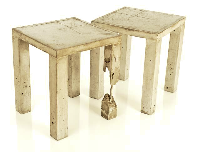 Two concrete end tables that have a broken down look where you can see part of the rebar reinforcement.