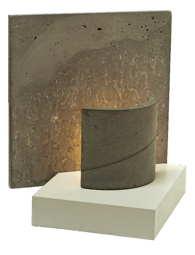 A light illuminates onto a concrete square making it light up.