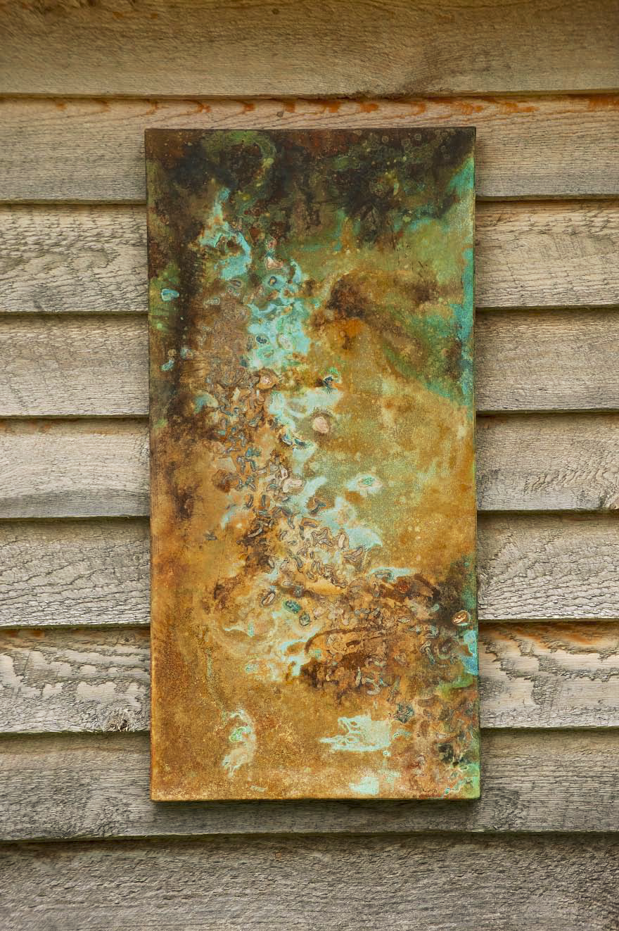 A sample of stained concete on a wooden background