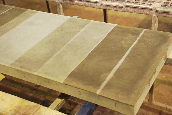 This test slab demonstrates how different sealers leave different-looking finishes on the same concrete.