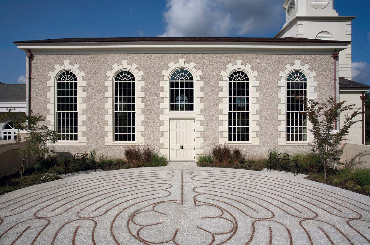 At the Bishop Gadsden Church in Charleston, S.C., artisans used tilt-up panels with a tabby finish and detailed quoins to match historic details on the existing church structure. They avoided the expense of hand-laid masonry and oyster shell stucco.