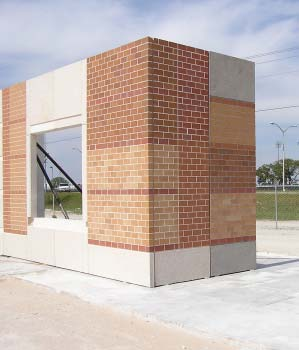 Tilt-Up Walls - A mock-up panel of window and brick work for an American Constructors Inc. project. It shows two different mix designs and sandblasting.