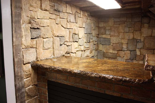 For the color, I usually mix up a few base colors which I dilute with varying amounts of white color. I spray each textured rock or brick and then start adding colors on top to provide depth and contrast of colors.