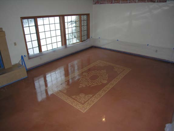 Mauve epoxy floor with a stenciled rug.