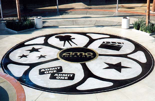 Overlayment with black stain featuring the AMC Theater logo movie reel.