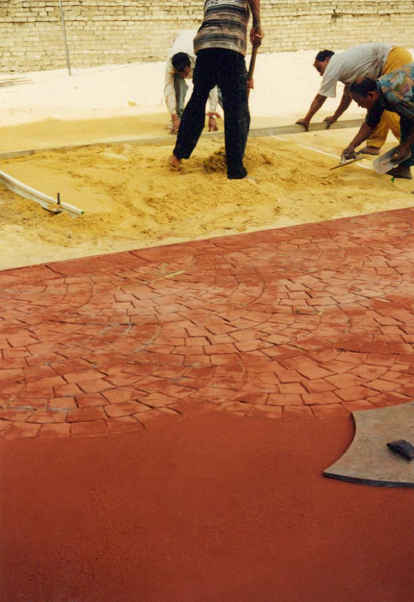 To train workers in Egypt, fine sand was utilized to practice screeding, floating, finishing, and stamping concrete