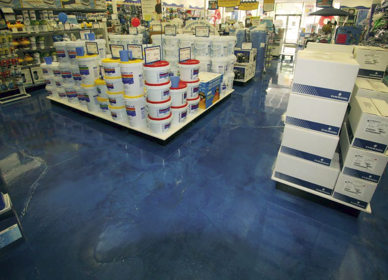 Transformed floors at swimming pool supply store look like water that has been achieved with epoxy.