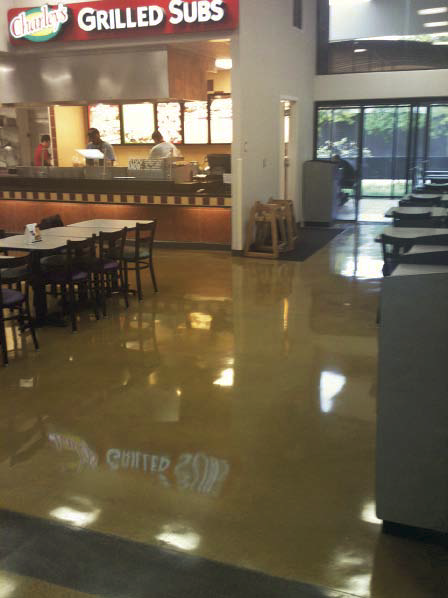 A food court in a mall with polished concrete
