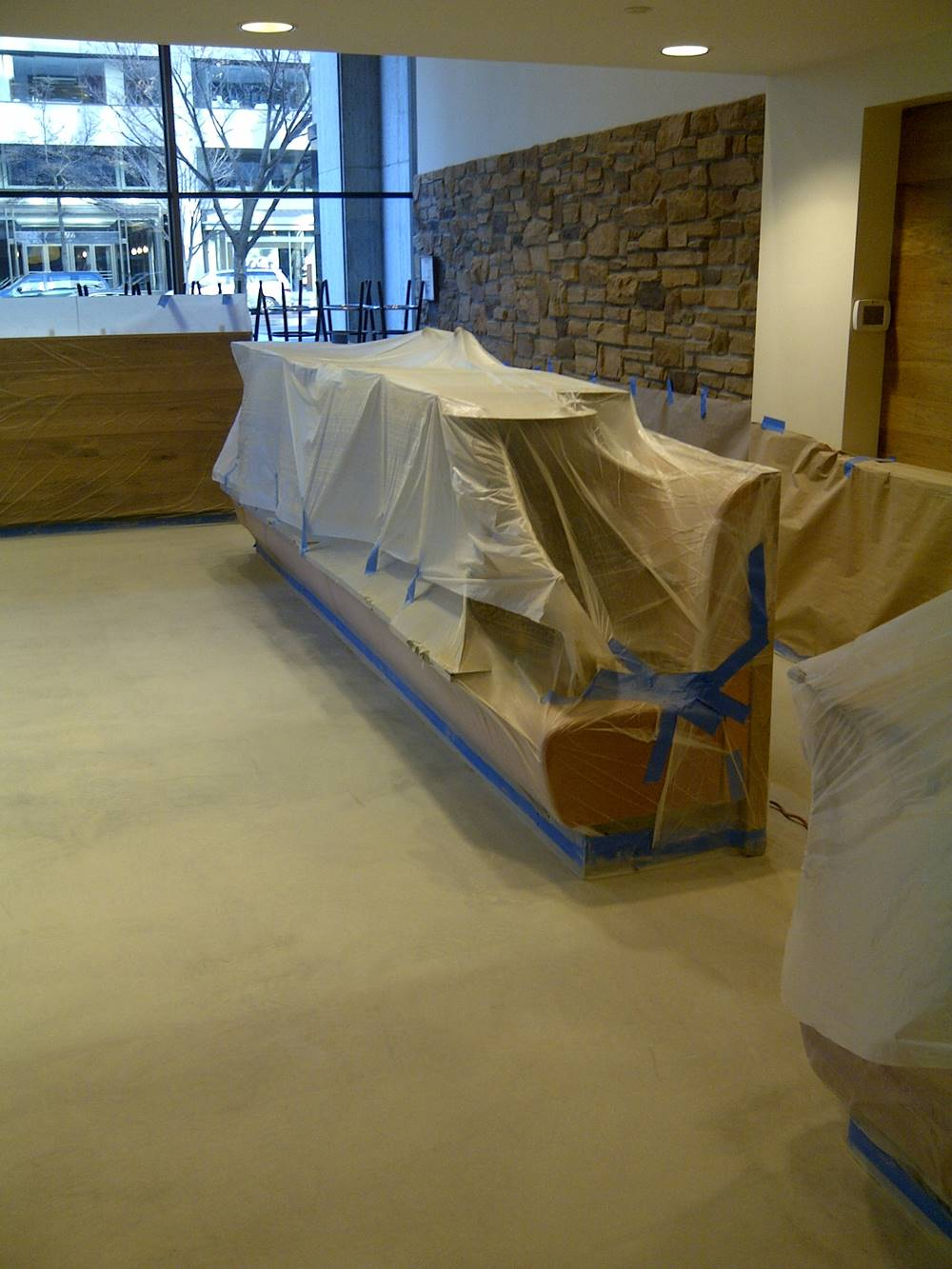 prep for concrete staining with plastic and paper are cheaper. it is cheaper than redoing to paint.