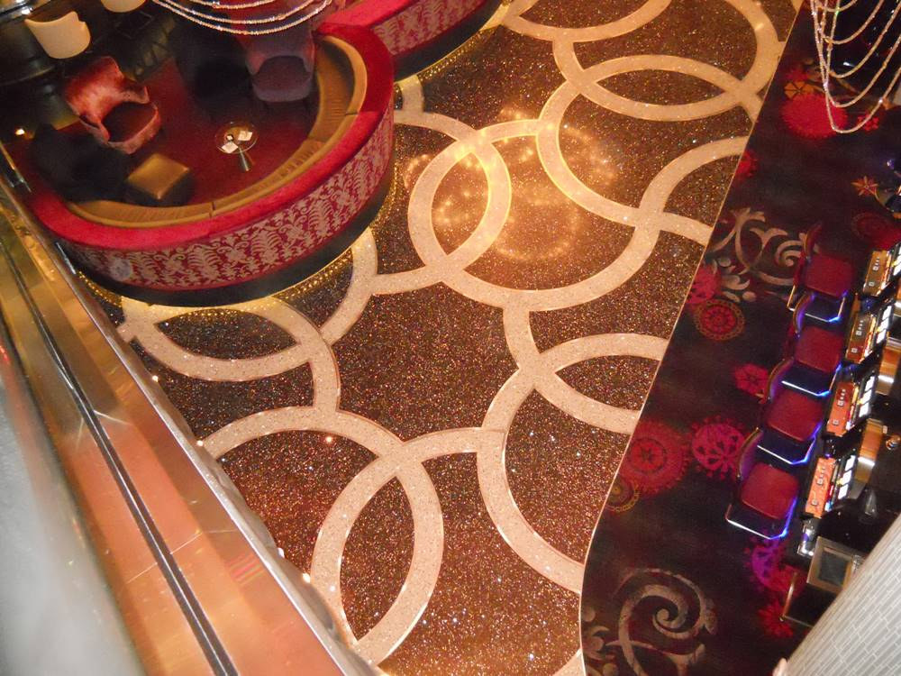 The first thing that any of those visitors sets foot on is a gloriously glitzy porte-cochere (the covered valet area), for which ArCon installed an entirely new cement-based terrazzo finish.