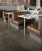 Diner with brown polished concrete floors gives a rich beautiful finish to the space under the booths.