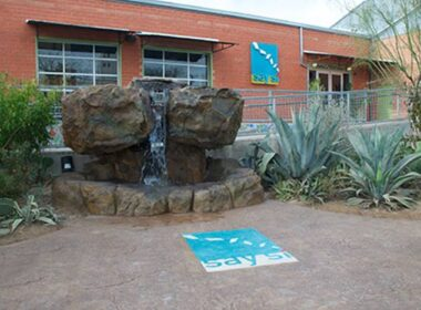 The front entrance of Say Si with a carved water feature and stamped patio with fiber optics.