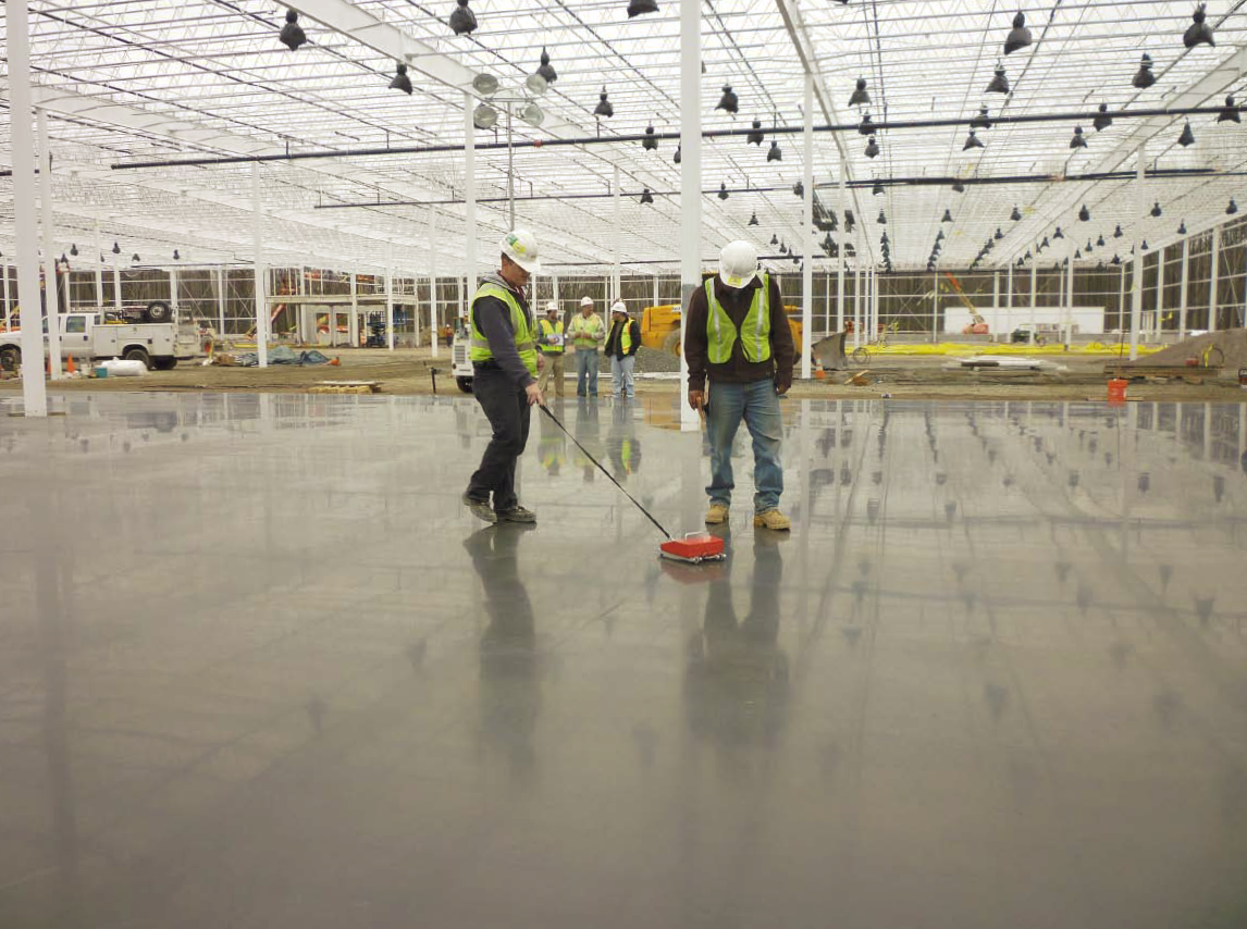 Workers for testing company ATC Associates Inc. take flatness readings at a future Costco store in New Jersey. Photo by Jennifer A. Faller