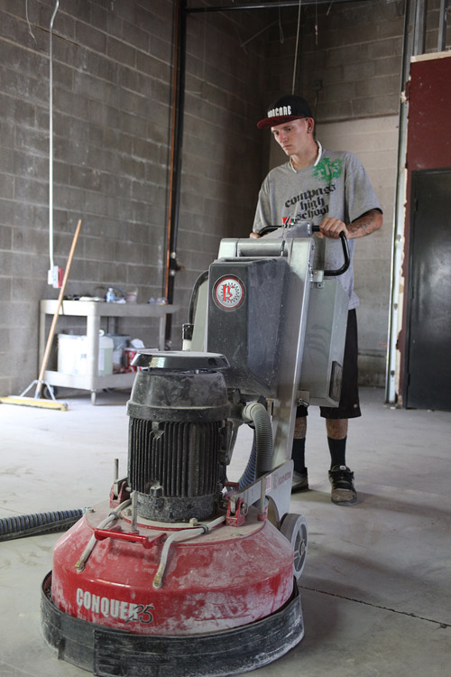 Compass High School student runs a concrete polishing machine to learn the finer parts of polishing concrete