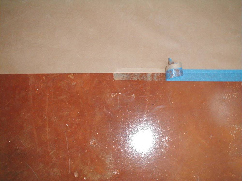 problems with tape on concrete can arise like here with the blue painter's tape on stained concrete
