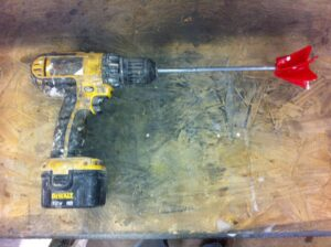 A drill with a mixing blade used for mixing concrete countertop sealers