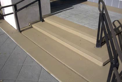 Integrally colored concrete stairs that are need of color restoration.