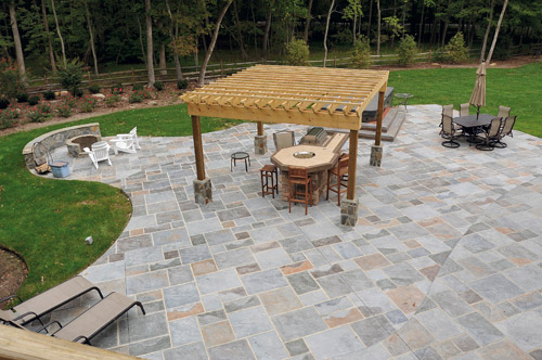 Stamped concrete patio and fire pit in muted slate colors.