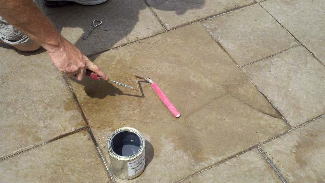 Rolling xylene on a dull and blushing sealed concrete surface can help clear the sealer and bring back the luster.