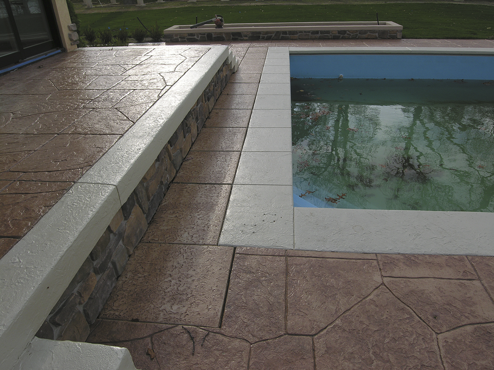 a pool deck with added shark grip in an effort towards fixing slippery stamped concrete