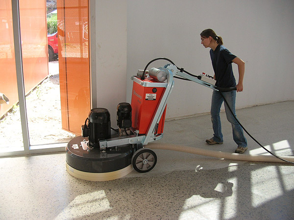 Using a grinder on a concrete floor