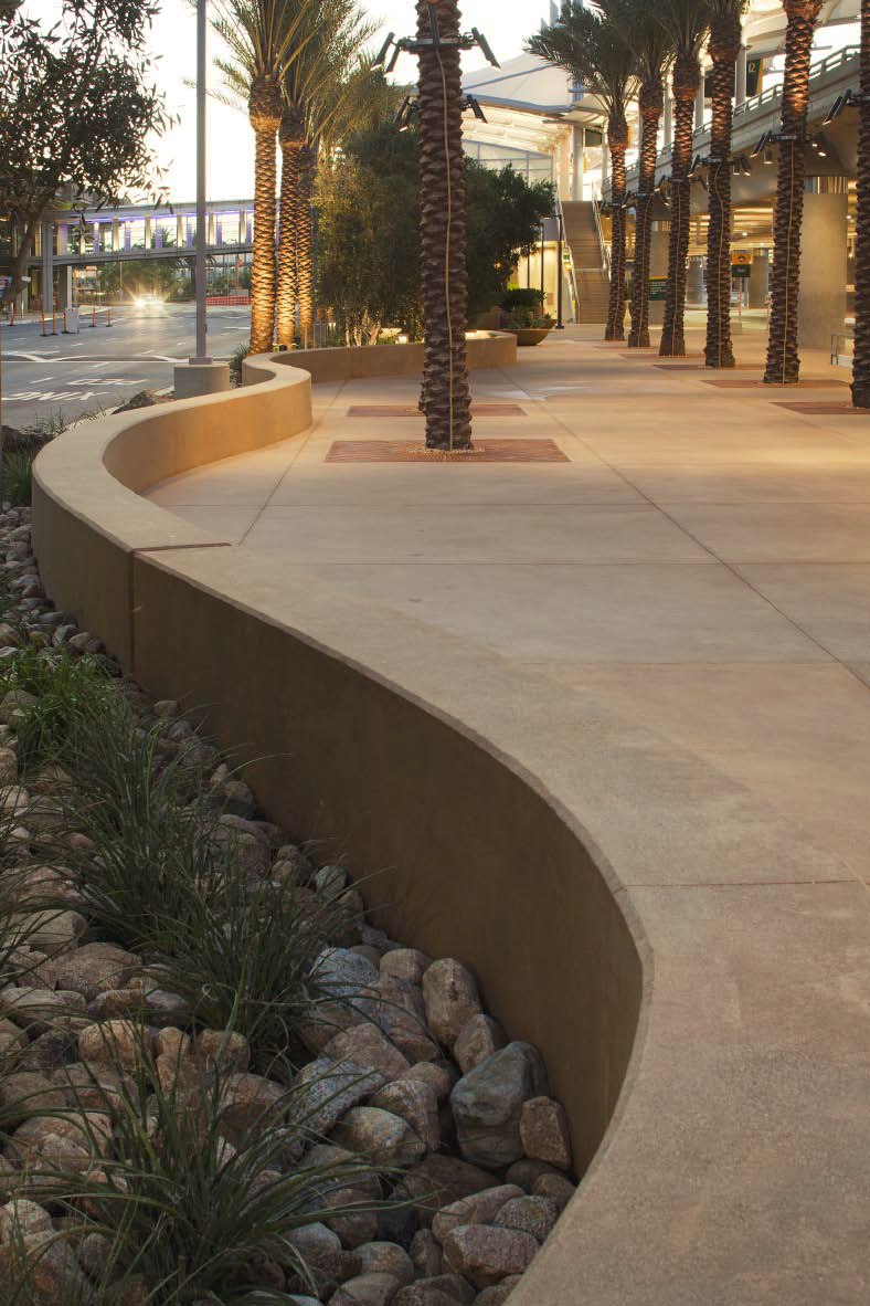 Decorative concrete at the airport includes a meandering wall that is both attractive and functional.