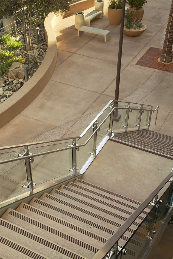 In addition to benches and trash cans, Quick Crete Products precast stair treads for T.B. Penick & Sons.