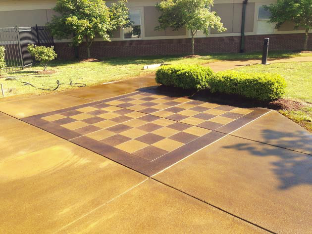 A life size concrete checkerboard that was stained in light and darker alternation colors.