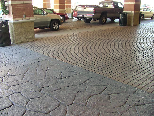 Hotel drop off area with two treatments of stamped concrete.
