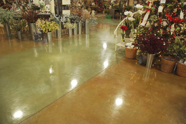 Polished and dyed concrete floor in a light green and brown.