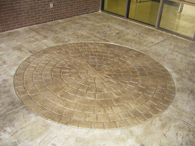 Radial stamped concrete pattern in an entryway.