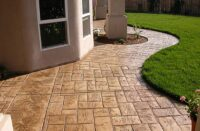 a stamped concrete patio with sealer on it