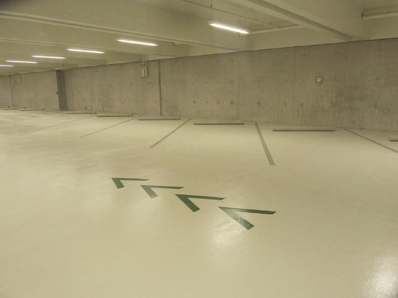 Parking garage with a concrete coating.
