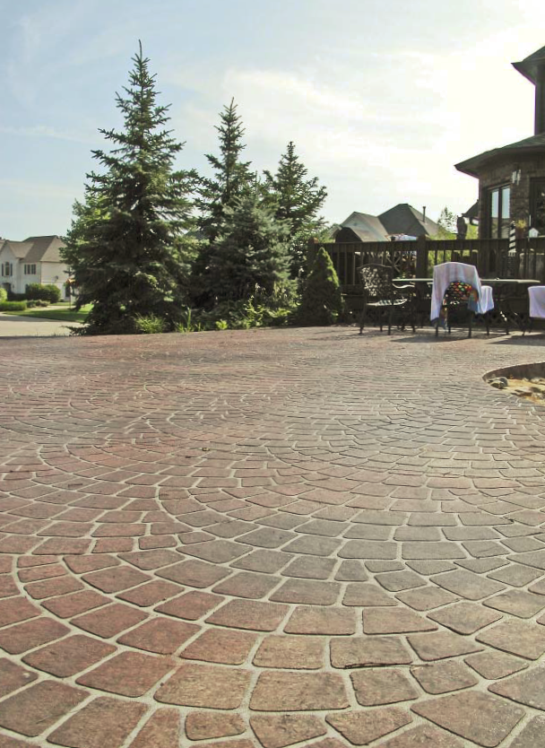 Stamped concrete in a patio setting that looks like old world stone.