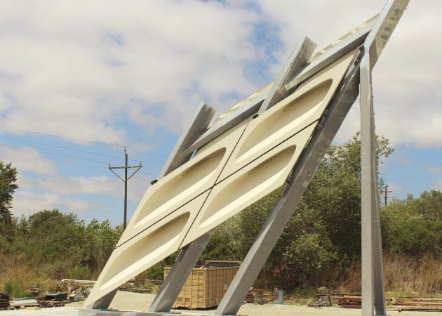 The completed panels and their steel frames are supported by a complex grid of structural steel members.