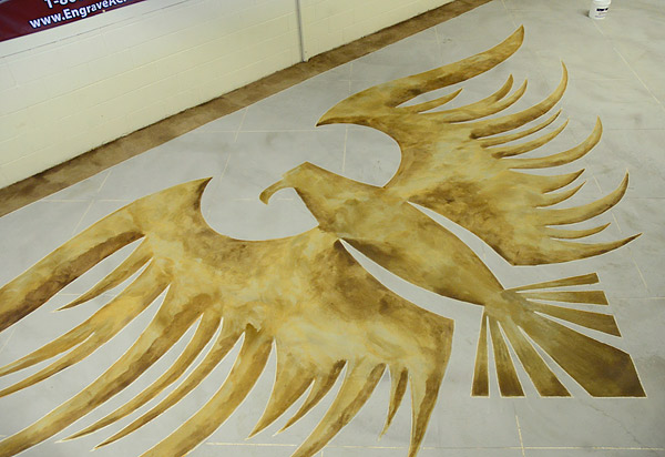 "In the middle of the room, Lobdell and his students engraved and acid-stained an eagle with a 28-foot wingspan. Owen says the new and improved loft doesn't look ""so institutional"" anymore. The eagle ""has livened up everything."""