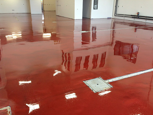 Metallic colored concrete floor in red