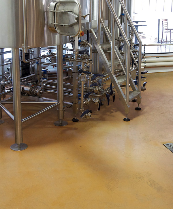Polished concrete brewery floor - The brewing area floor at San Diego's Ballast Point Brewing & Spirits features Temper-Crete urethane cement in Straw from Westcoat. A urethane cement coating and polyurea top coat gives brewers a durable, easy-to-clean surface that is resistant to chemicals, heat and impacts.