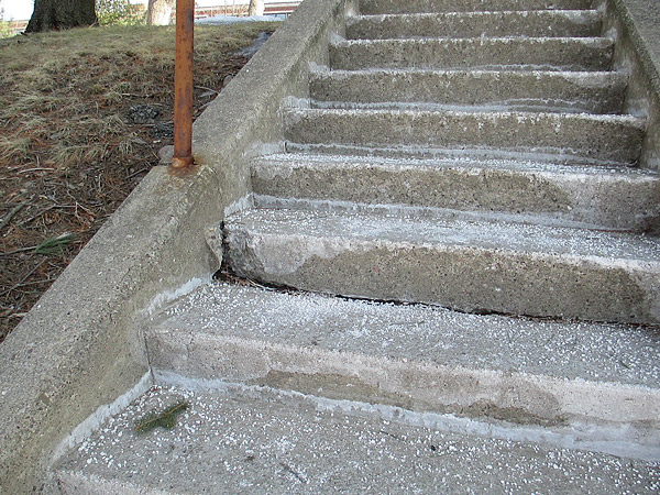 Marywood University in Pennsylvania liberally de-ices its stairs, shown here. The concrete is breaking down from repeated freeze-thaw cycles. The white film is salt leaching into the concrete. Photo courtesy of Bart Sacco
