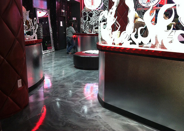Liquid Dazzle WestCoat concrete floor - Owners of Vegas Ink opted to use Liquid Dazzle from Westcoat, an epoxy coating system with metallic additives, over conventional acid staining to produce the one-of-a-kind floor they were seeking.