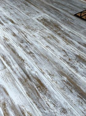 weathered looking concrete that takes on the look of wood floors.