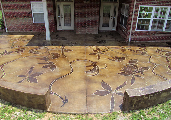 engraved concrete patio with flowers