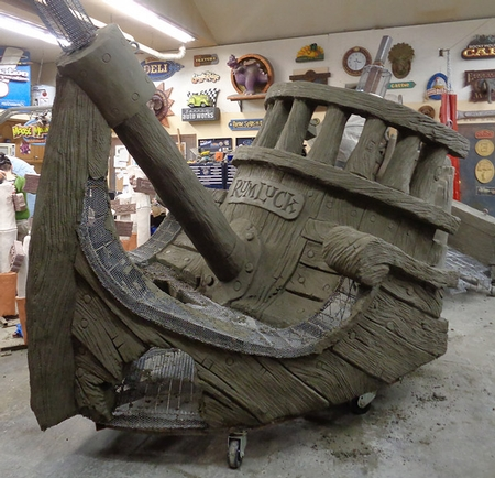 A shipwrecked boat made of concrete.