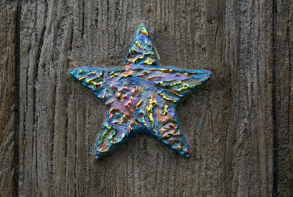 concrete star carved for mural