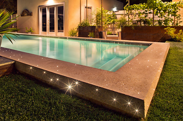 swimming pool with LED lights in the coping that was placed in the forms prior to pouring the concrete