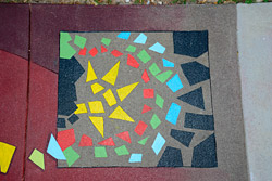 multicolored concrete mosaic on dual colored floor