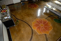 stained flowers and vines on concrete floors