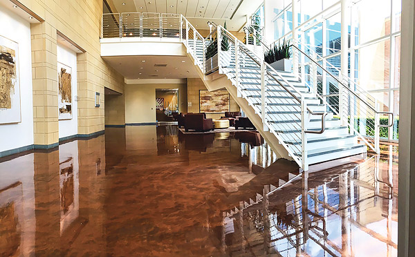 concrete epoxy floors - Concrete Solutions Metal Fusion system by Rhino Linings graces this lobby of the Sabre building in Southlake, Texas. Photo courtesy of Rhino Linings Corp.